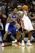 Jan 31, 2010; Cleveland, OH, USA; Cleveland Cavaliers forward LeBron James (23) tries to find a way around Los Angeles Clippers guard Rasual Butler (45) during the third quarter at Quicken Loans Arena. The Cavaliers beat the Clippers 114-89. Mandatory Credit: Jason Miller-US PRESSWIRE
