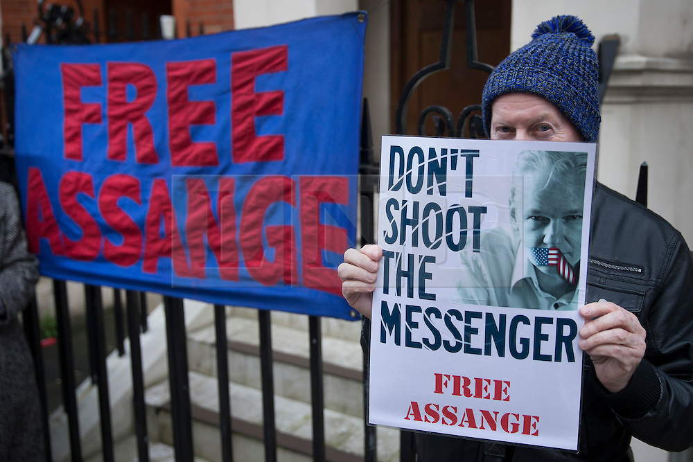 © Licensed to London News Pictures. 04/02/2016. London, UK. A supporter of Julian Assange stands near the Ecuadorian Embassy where the Wikileaks founder is living.  A United Nations panel is due to decide if Julian Assange has been kept in 'unlawful detention' during his stay at the embassy for the past three-and-a-half-years. Photo credit: Peter Macdiarmid/LNP