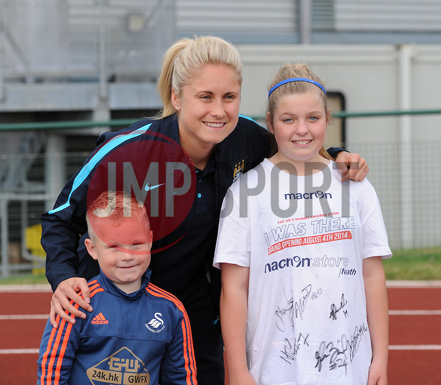 Manchester City Women's Stephanie Houghton poses for a photo with young supporters at Stoke Gifford Stadium before facing Bristol Academy in Women's Super League - Photo mandatory by-line: Paul Knight/JMP - Mobile: 07966 386802 - 18/07/2015 - SPORT - Football - Bristol - Stoke Gifford Stadium - Bristol Academy Women v Manchester City Women - FA Women's Super League