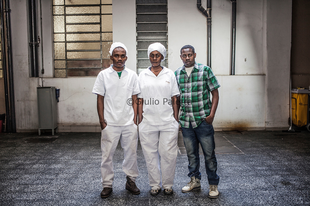 Dims, Beaussefour and Jean-Paul, three young Haitians working at an Italian bakery in Mooca neighbourhood in São Paulo, Brazil