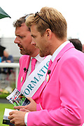 Michael Shinners of Sky Bet and Tom Stanley of Racing UK don pink suits and assist the famous York Pink Ladies for the day at York Racecourse, York, United Kingdom on 13 July 2018. Picture by Mick Atkins.