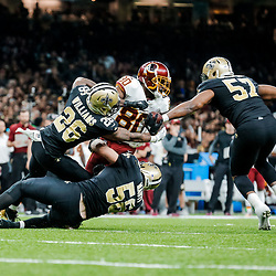 Nov 19, 2017; New Orleans, LA, USA; New Orleans Saints cornerback P.J. Williams (26) and defensive end Alex Okafor (57) and linebacker Michael Mauti (56) tackle Washington Redskins wide receiver Jamison Crowder (80) during the second half of a game at the Mercedes-Benz Superdome. The Saints defeated the Redskins 34-31 in overtime. Mandatory Credit: Derick E. Hingle-USA TODAY Sports