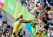 RIO DE JANEIRO - Usain Bolt tijdens de 100 meter tijdens de Olympische Spelen van Rio. ROBIN UTRECHT