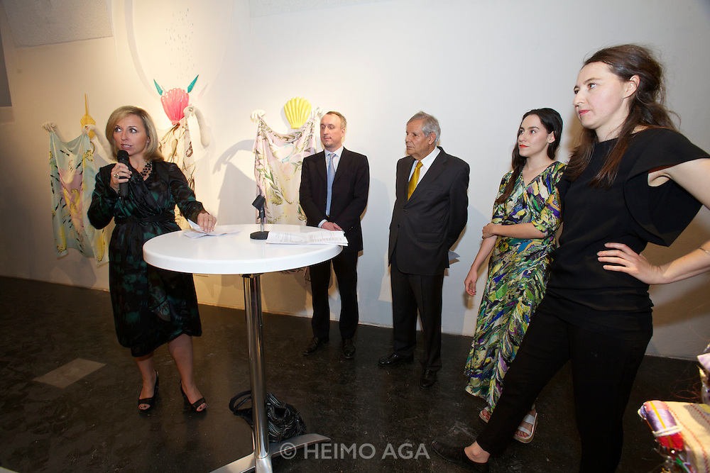 """Vienna. MuseumsQuartier (MQ Vienna) is celebrating its 10th year..Daniela Enzi, Museum Quarter Director (speaking), from r.: Elisabeth Hajek, Curator Lliure Briz, the Spanish Ambassador to Vienna, unknown..Where does fashion end and art begin? This question is at the center of the exhibition """"GET IN THE HAZE"""" at freiraum quartier21 INTERNATIONAL. Curated by Lliure Briz (ESP) and opening on May 19, the show takes a close look at recognized fashion designers and artists who are not afraid of hybrid art forms."""