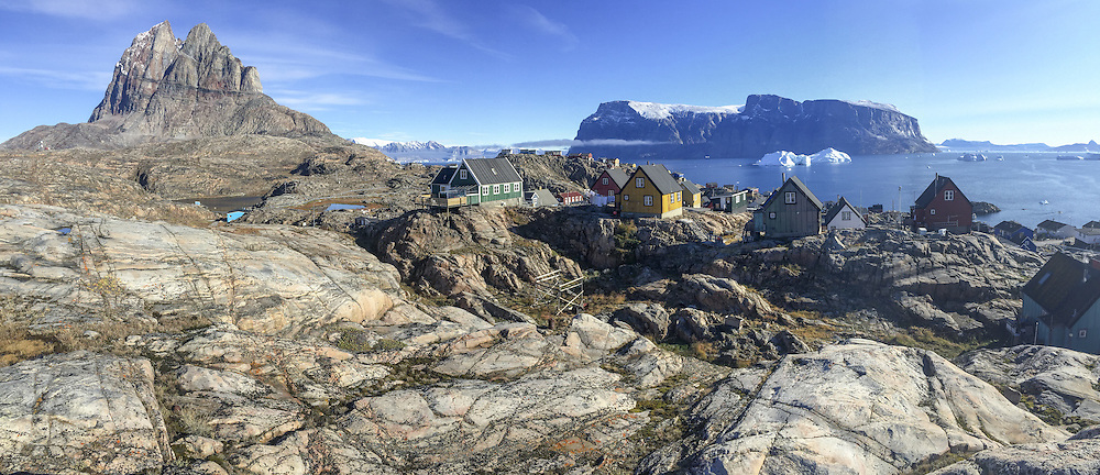 Uummannaq Mountain, colorful homes and Karajak Fjord from Qilakitsoq in Uummannaq, Greenland.