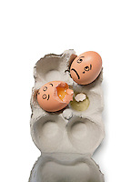 Eggs in a carton with one egg broken