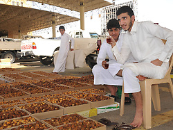 60366648  <br /> Salesmen drink red tea as they sell date palms at the world s biggest date palm market in Buraidah, some 300 km north of Riyadh, capital of Saudi Arabia, Aug. 18, 2013. There are 23 million date palm trees in Saudi Arabia, while the annual output of date palms amount to millions of tons, Sunday, August 18, 2013. <br /> Picture by imago / i-Images<br /> UK ONLY
