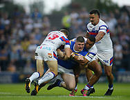 Mitch Garbutt (C) of Leeds Rhinos tackled by Tyler Randell (L) and Reece Lyne (R) of Wakefield Trinity during the Betfred Super League match at Emerald Headingley Stadium, Leeds<br /> Picture by Stephen Gaunt/Focus Images Ltd +447904 833202<br /> 13/07/2018