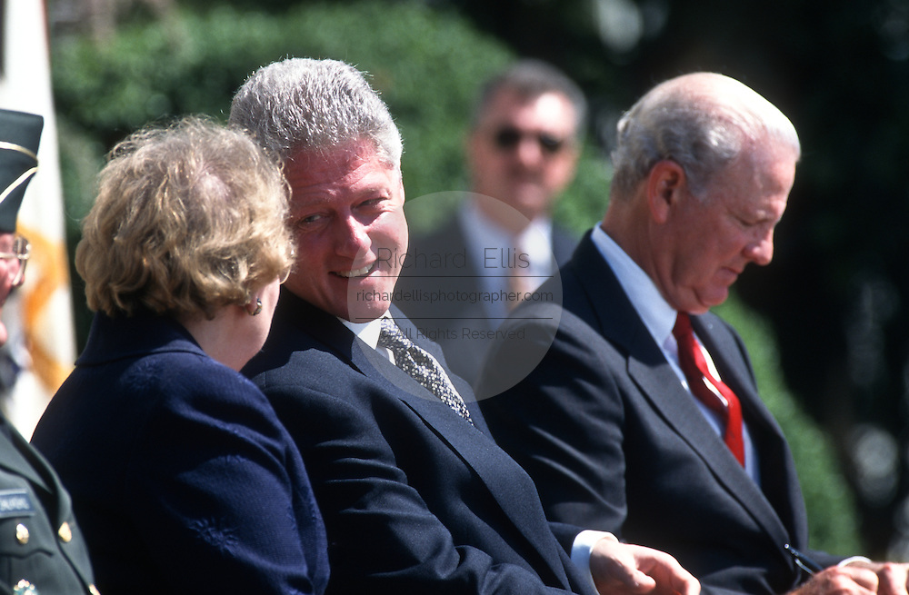 Secretary of State Madeleine Albright talks with President Bill Clinton during an event on the Chemical Weapons Ban treaty at the White House event April 4,1997 in Washington, DC.