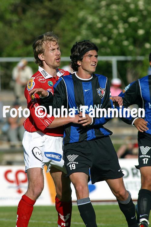 30.05.2002, Pori, Finland..Veikkausliiga 2002 / Finnish League 2002..FC Jazz Pori v FC Inter Turku..Aristides Pertot (Inter - blue) v Juha Riippa (Jazz).©Juha Tamminen