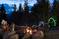 Girls at Whistler Blackcomb Tube Park, campfire in the evening, in Whistler, BC Canada.