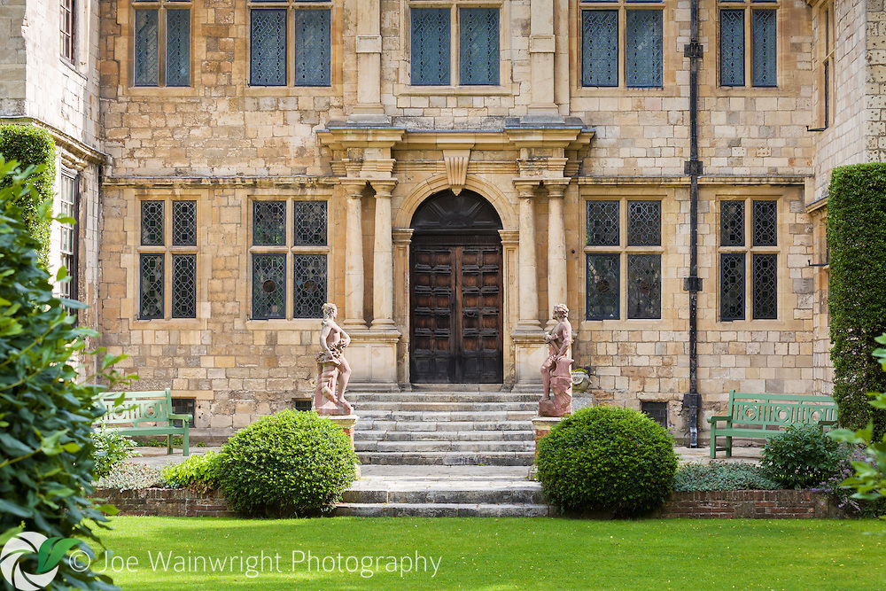 Statues guard the doorway to the medieval Treasurer's House, York.