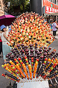 Candied fruit on a stick known as Tanghulu or bingtanghulu for sale along Wangfujing Street in Beijing, China