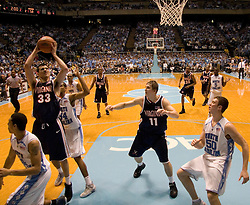 Virginia's Jason Cain (33) gets a shot off against UNC.  The #1 ranked Tar Heels beat the Cavaliers 79-69 to improved to 15-1 overall, 2-0 ACC on January 10, 2007 at the Dean Smith Center in Chapel Hill, NC...<br />