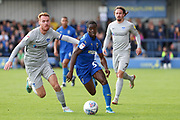 AFC Wimbledon defender Paul Osew (37) dribbling past Portsmouth midfielder Tom Naylor (4) during the EFL Sky Bet League 1 match between AFC Wimbledon and Portsmouth at the Cherry Red Records Stadium, Kingston, England on 19 October 2019.