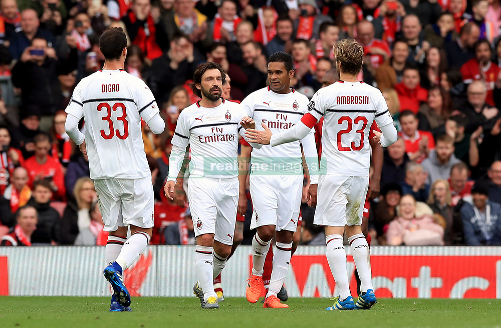 Milan's Andrea Pirlo (second from left) celebrates scoring his side's first goal of the game during the Legends match at Anfield Stadium, Liverpool.