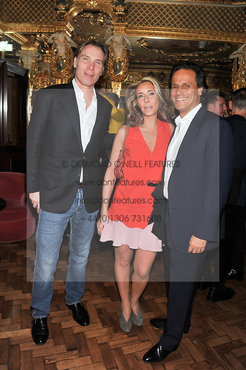Left to right, DAMIAN ASPINALL, TARA BERNERD and ARUN NAYAR at the 50th birthday party for Patrick Cox held at the Café Royal Hotel, 68 Regent Street, London on 15th March 2013.