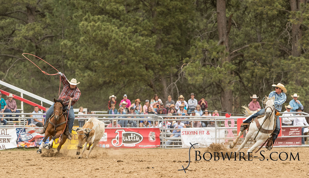 Header Jase Staudt and heeler Hank Bounds make their team roping run during the third performance of the Elizabeth Stampede on Sunday, June 3, 2018.