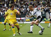 Photo: Steve Bond.<br />Derby County v Leeds United. Coca Cola Championship. 06/05/2007. Robert Bayly (L) forces Morten Bisgaard wide (R)