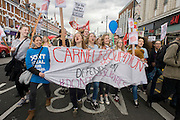 Teenage campaigners against the closure by Lambeth council  of Carnegie Library in Herne Hill, south London, charge through Brixton, after emerging from the premises on the 10th day of occupation, 9th April 2016. The local community have been occupying their important resource for learning and social hub and after a long campaign, Lambeth have gone ahead and closed the library's doors for the last time because they say, cuts to their budget mean millions must be saved. They plan to re-purpose it into a gym although details are unknown.