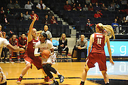 "Mississippi's Danielle McCray (22) scores and is fouled by Arkansas' Melissa Wolff (33) at the C.M. ""Tad"" Smith Coliseum in Oxford, Miss. on Friday, January 2, 2015. (AP Photo/Oxford Eagle, Bruce Newman)"