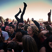Fans body surf to the music of Primus during the BottleRock festival at the Napa Valley Expo in Napa, Calif.