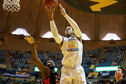 Dec 16, 2017; Morgantown, WV, USA; West Virginia Mountaineers forward Sagaba Konate (50) shoots in the lane during the second half against the Wheeling Jesuit Cardinals at WVU Coliseum. Mandatory Credit: Ben Queen-USA TODAY Sports