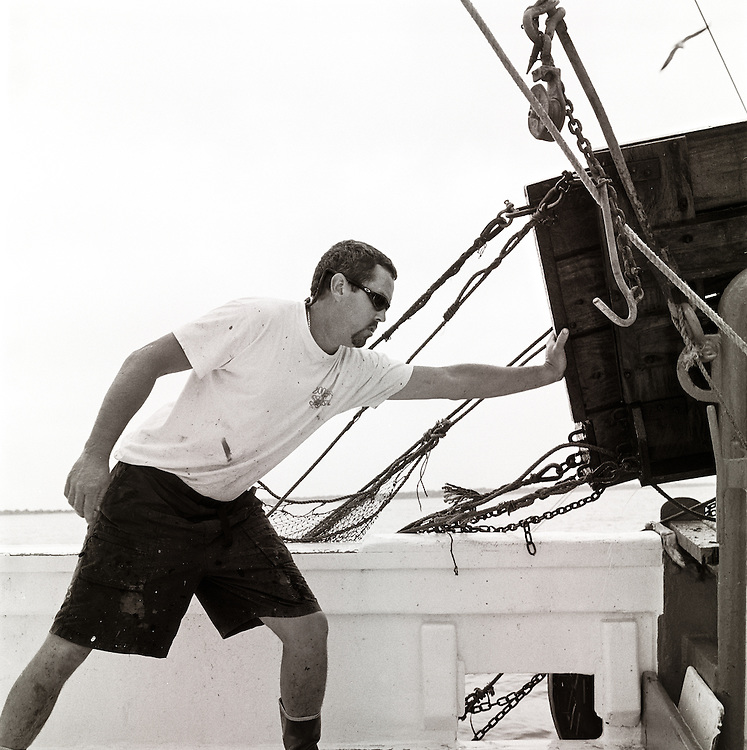 Striker Mark White guides the doors onto the boat | Summer 2003