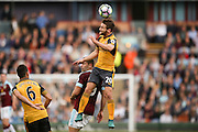 Arsenal defender Shkodran Mustafi (20)  wins the header  during the Premier League match between Burnley and Arsenal at Turf Moor, Burnley, England on 2 October 2016. Photo by Simon Davies.