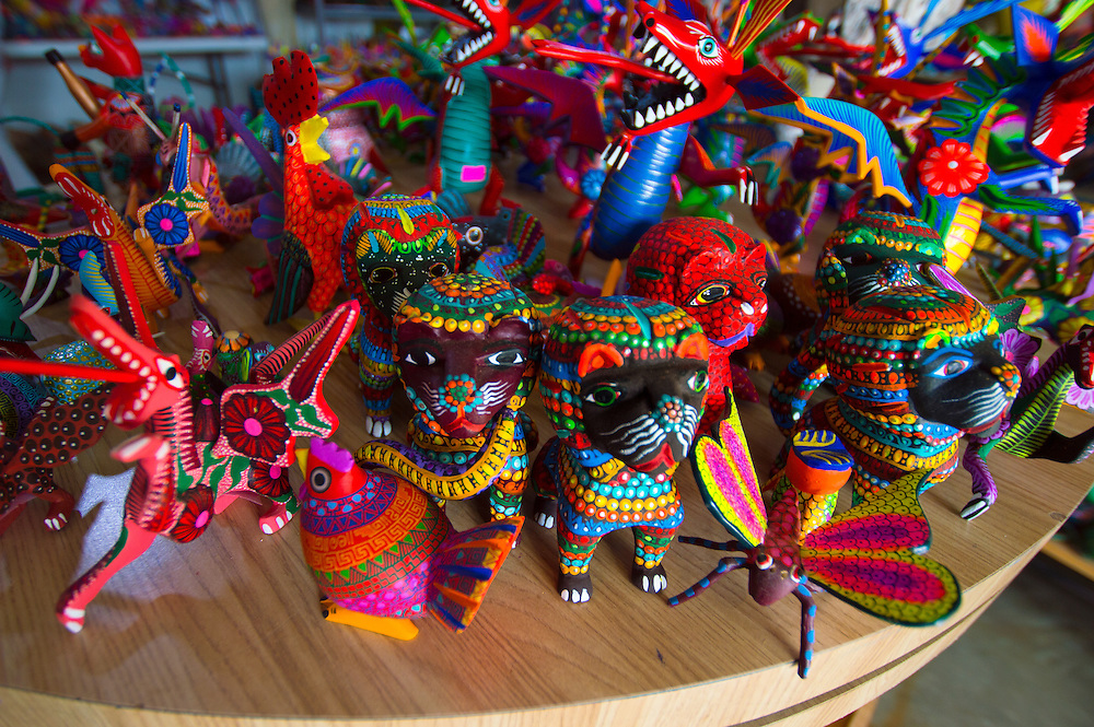 Alebrijes are figures made out of carved wood and are found at Arrazola in the state of Oaxaca.