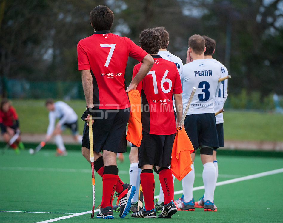 Southgate's Fergus Dunn & Timmy Smyth wait to get on along with Mark Pearn of East Grinstead. Southgate v East Grinstead - Now: Pensions Hockey League Premier Division, Trent Park, London, UK on 01 February 2015. Photo: Simon Parker