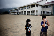Fukushima city, July 31st 2011 - Fu Nishikata, 8, and her brother Kaito, 12, on the playground of the school they left on April 1st to evacuate to Yonezawa, 50km away. Their mother, Kanako Nishikata, is member of a group of parents for the protection of Fukushima children.