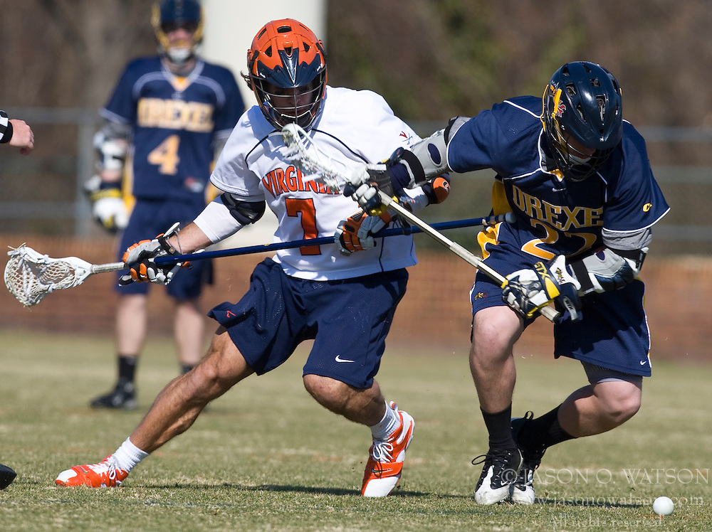 Virginia Cavaliers D Chad Gaudet (7) battles with Drexel Dragson M Ryan West (22) for the ball.  The #2 ranked Virginia Cavaliers defeated the Drexel Dragons 13-7 at the University of Virginia's Klockner Stadium in Charlottesville, VA on February 14, 2009.