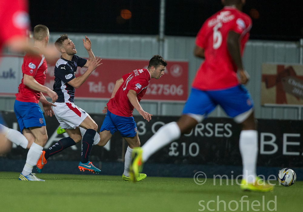Falkirk's Rory Loy hurt by Cowdenbeath's Darren Brownlie. <br /> Falkirk 1 v 0 Cowdenbeath, William Hill Scottish Cup game played 29/11/2014 at The Falkirk Stadium.