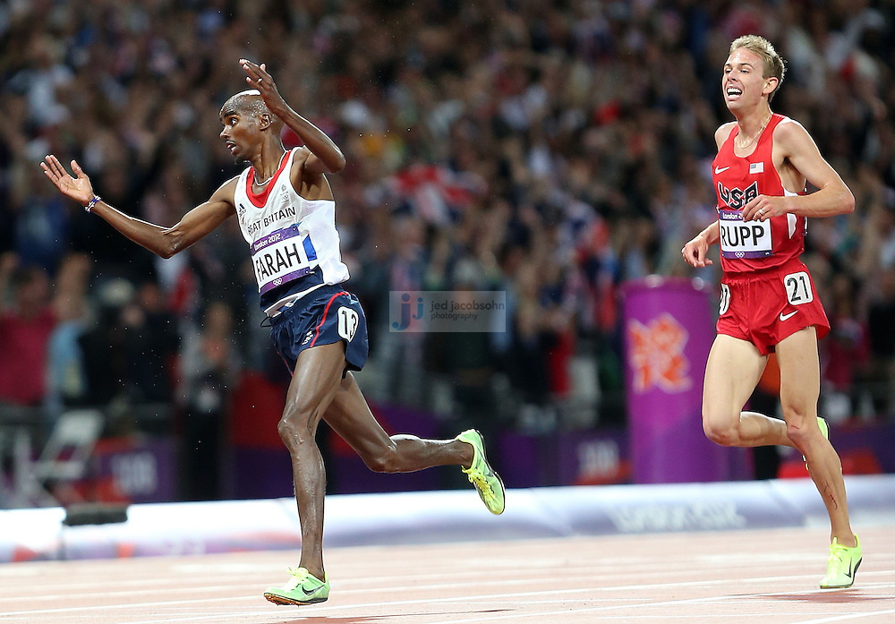 Mohamed Farah of Great Britain and Galen Rupp of the USA cross the finish line after th 10000m final during track and field at the Olympic Stadium during day 8 of the London Olympic Games in London, England, United Kingdom on August 3, 2012..(Jed Jacobsohn/for The New York Times)..