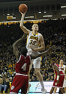 December 31 2012: Iowa Hawkeyes forward Aaron White (30) puts up a shot over Indiana Hoosiers guard Victor Oladipo (4) during the first half of the NCAA basketball game between the Indiana Hoosiers and the Iowa Hawkeyes at Carver-Hawkeye Arena in Iowa City, Iowa on Monday December 31, 2012. Indiana defeated Iowa 69-65.