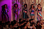 Indian models display creations by designer Manish Arora at a fashion show in New Delhi, India, Saturday, March 6, 2004. (AP Photo/Sebastian John)