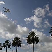 A sea plane takes off from the Port of Miami. Photography by Jose More