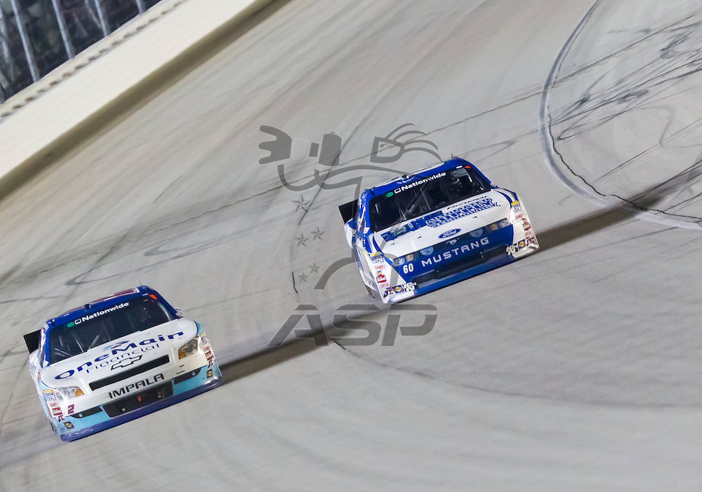 JOLIET, IL - JUNE 04, 2011:  Elliot Sadler (2) battles for position during the STP 300 race at the Chicagoland Speedway in Joliet, IL.