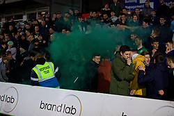 NEWPORT, WALES - Wednesday, December 21, 2016: Plymouth Argyle supporters set off a green smoke bomb, after their side miss a penalty against Newport County during the FA Cup 2nd Round Replay match at Rodney Parade. (Pic by David Rawcliffe/Propaganda)