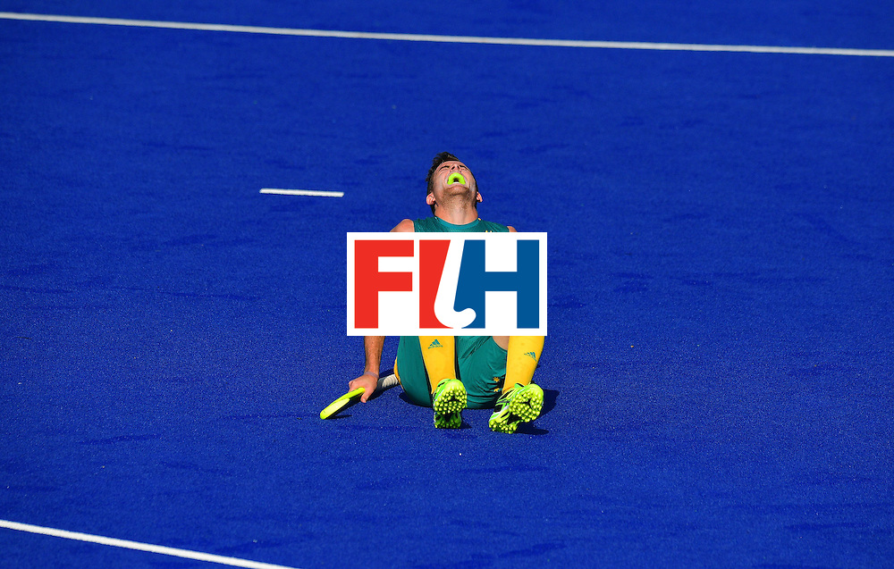 Australia's Jacob Whetton reacts during the men's field hockey Australia vs New Zealand match of the Rio 2016 Olympics Games at the Olympic Hockey Centre in Rio de Janeiro on August, 6 2016. / AFP / CARL DE SOUZA        (Photo credit should read CARL DE SOUZA/AFP/Getty Images)