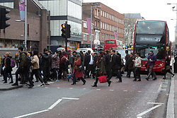 "© Licensed to London News Pictures. 18/01/2016. London, UK. Commuters cross the road outside Waterloo Station this morning. Today, known as ""Blue Monday"" is meant to be the most depressing day of the year. Photo credit : Vickie Flores/LNP"