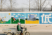 Hand painted mural describing the benefits of solar energy on the walls of Yingli Solar, one of the largest producers in the world of solar modules.