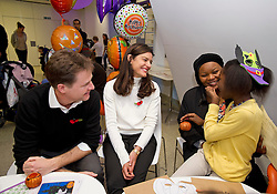 © London News Pictures. 31/10/2013 . London, UK.  Deputy Prime Minister NICK CLEGG and his wife MIRIAM GONZALEZ DURANTEZ meet MONICA DIMBU (right, aged 8) while visiting children, parents and volunteers at the Great Ormond Street Hospital annual Halloween party.  Photo credit : Ben Cawthra/LNP
