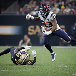 Sep 9, 2019; New Orleans, LA, USA; Houston Texans running back Carlos Hyde (23) runs past New Orleans Saints outside linebacker Demario Davis (56) during the second quarter at the Mercedes-Benz Superdome. Mandatory Credit: Derick E. Hingle-USA TODAY Sports
