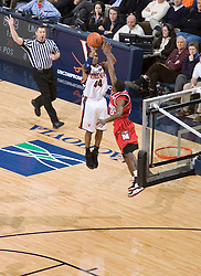 Virginia's Sean Singletary (44) shoots one of his three 3 pointers against Maryland.  The Cavaliers defeated the #22 ranked Terrapins 103-91 at the John Paul Jones Arena in Charlottesville, VA on January 16, 2007.