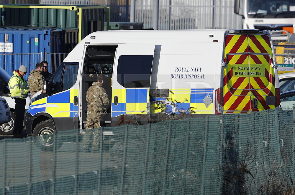 © Licensed to London News Pictures. 12/02/2018. London, UK. A Royal Navy Bomb Disposal team arrives at London City Airport which remains closed after a World War II era bomb was found in The River Thames during routine work on nearby King V Dock. Police have evacuated nearby residents, closed the airport and set up a 214-metre exclusion zone. Photo credit: Peter Macdiarmid/LNP