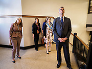 """08 APRIL 2019 - DES MOINES, IOWA: Rep. TIM RYAN (right) and his wife, ANDREA RYAN (left), walk through the halls with school administrators at Callanan Middle School. Ryan, a candidate for the Democratic ticket of the US presidency, visited Callanan Middle School in Des Moines to discuss education issues. Ryan declared his candidacy on the US television show """"The View"""" on April 4. Ryan, 45 years old, represents Ohio's 13th District, which includes Lordstown, where a large General Motors plant recently closed. He is the latest Democrat to announce his candidacy to be the Democratic nominee in the 2020 election. Iowa holds its presidential caucuses on Feb. 3, 2020.      PHOTO BY JACK KURTZ"""