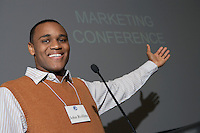 Business man giving presentation at conference meeting, portrait