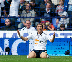 BOLTON, ENGLAND - Sunday, September 26, 2010: Bolton Wanderers' Johan Elmander looks dejected after missing a chance in front of the Manchester United goal during the Premiership match at the Reebok Stadium. (Photo by David Rawcliffe/Propaganda)